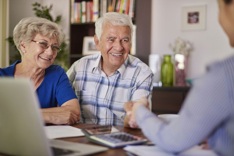 Senior couple meeting with caregiver